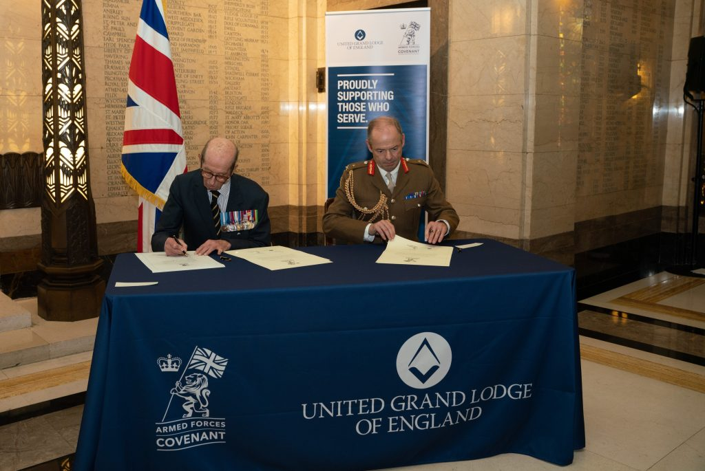 The Grand Master and Major General Simon Graham, Director Reserves Army, signing the Covenant